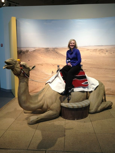 WHO Reporter, Megan Salois, having her photo taken with the fiberglass Camel